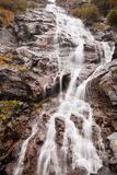 Capra Waterfall. Vertical view of Capra Waterfall during autumn in Fagarasi Natural Park, Romania Stock Photo