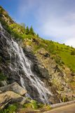Capra waterfall on the course of the river Capra by the famous road Transfagarasan Royalty Free Stock Photo