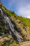 Capra waterfall on the course of the river Capra by the famous road Transfagarasan Royalty Free Stock Photography