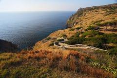 Capraia island shore and path to castle Elba, Tuscany, Italy, Eu Stock Images