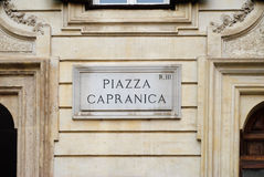 Capranica Square, street plate on a wall in Rome, Italy Royalty Free Stock Images
