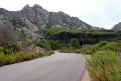 Caprera island road. Road on the island of Caprera in Sardinia Royalty Free Stock Images