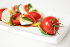 Caprese. Cherry tomatoes and mozzarella with olive oil and balsamic vinegar Royalty Free Stock Photography