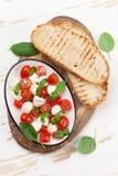 Caprese bruschetta toasts cooking Royalty Free Stock Image