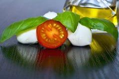 Caprese salad. Classic caprese salad. Italian traditional caprese salad ingredients. Mediterranean food. Royalty Free Stock Photo