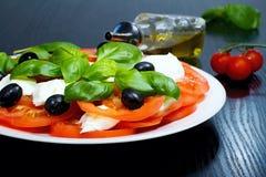 Caprese salad. Classic caprese salad. Italian traditional caprese salad ingredients. Mediterranean food. Stock Images