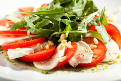 Caprese con Rocket Salad Immagine Stock