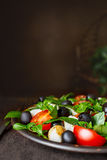 Caprese with mozzarella, tomatoes, basil and olives. Classic Italian salad. Classic Italian salad with mozzarella, tomatoes, basil, olives and olive oil stock photo