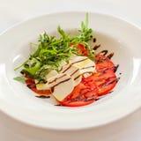 Caprese with pesto. Fresh salad with tomato and mozzarella Stock Images