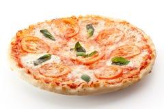 Caprese Pizza. Pizza Caprese made with Mozzarella, Tomatoes, Oregano and Basil royalty free stock photos