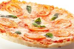 Caprese Pizza. Pizza Caprese made with Mozzarella, Tomatoes, Oregano and Basil stock photo