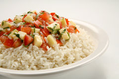 Caprese rice. A mediterranean recipe of rice, tomatoes, basil, and mozzarella cheese Stock Images