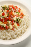 Caprese rice. A mediterranean recipe of rice, tomatoes, basil, and mozzarella cheese Stock Image