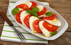Caprese Salad. Classic caprese salad: tomato, mozzarella and basil leaves Stock Photography