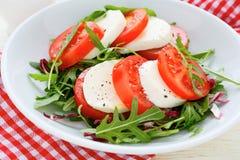 Caprese salad with arugula Royalty Free Stock Photography