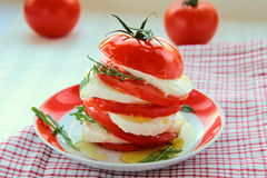 Caprese salad with arugula and olive oil Royalty Free Stock Photos
