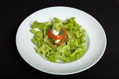 Caprese salad. Healthy Vegetarian Vegetarian Food. Caprese salad on the black background. Healthy Vegetarian Vegetarian Meal Stock Photo