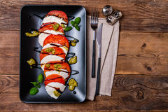 Caprese Salad on black plate Royalty Free Stock Photo
