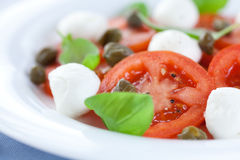 Caprese salad with capers Stock Photography