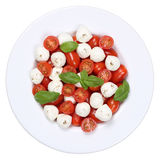 Caprese salad with cocktail tomatoes and mozzarella from above Stock Image