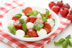 Caprese salad. Close up. Caprese salad with fresh tomatoes, mozzarella and basil. Antipasti. Close up Royalty Free Stock Images