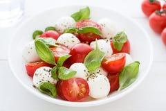 Caprese salad. Close up. Caprese salad with fresh tomatoes, mozzarella and basil. Antipasti. Close up Stock Photo