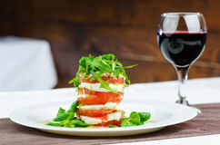 Caprese Salad With Glass Of Red Wine Royalty Free Stock Photography
