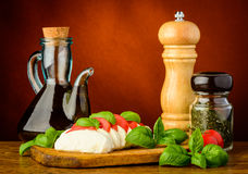 Caprese salad, herbs and spices Royalty Free Stock Photos