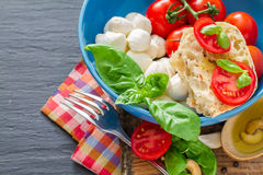 Caprese salad ingredients on dark stone background Royalty Free Stock Photography