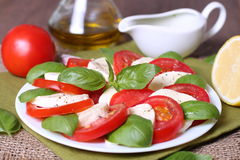 Caprese salad. With ingredients like oil, tomatoes and mozzarella cheese Stock Photos