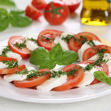 Caprese salad with ingredients like tomatoes and mozzarella chee Stock Photo