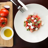 Caprese salad. With ingredients on wooden table Royalty Free Stock Photo