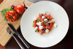 Caprese salad. With ingredients on wooden table Royalty Free Stock Photography