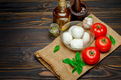 Caprese salad ingridients - Mozzarella and tomato. Caprese salad ingridients - Mozzarella cheese and tomato stock photo