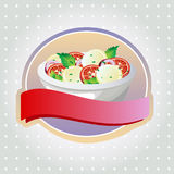 Caprese salad label. One full bowl of caprese salad italian food with ribbon Stock Photos