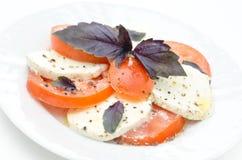 Caprese salad made with mozzarella cheese Stock Photo