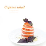 Caprese salad made with mozzarella cheese, tomatoes Royalty Free Stock Image