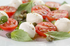 Caprese salad with mini mozzarella balls, tomatoes Stock Image