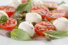 Caprese salad with mini mozzarella balls, tomatoes Stock Image