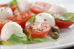 Caprese salad with mini mozzarella balls, tomatoes Stock Photos