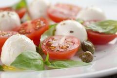 Caprese salad with mini mozzarella balls, tomatoes Stock Photos