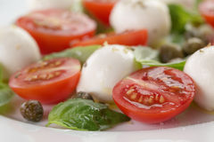 Caprese salad with mini mozzarella balls, tomatoes Stock Photography
