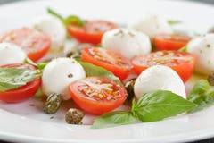 Caprese salad with mini mozzarella balls and Stock Photo
