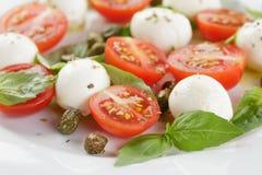 Caprese salad with mini mozzarella balls and Stock Images