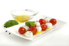 Caprese salad with mini mozzarella and tomatoes Royalty Free Stock Photos