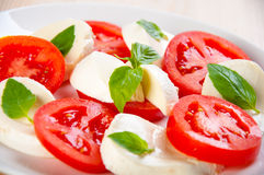 Caprese salad with mozarella cheese, tomatoes Royalty Free Stock Photos