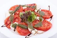 Caprese salad, mozarella cheese, tomatoes and basil Royalty Free Stock Photo