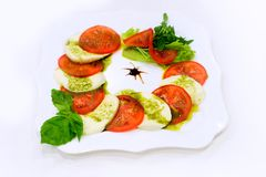 Caprese salad with mozzarella cheese, tomatoes and Stock Photos