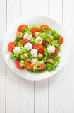 Caprese salad with mozzarella pearls and tomato Royalty Free Stock Image