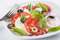 Caprese salad with mozzarella, tomato and basil Stock Photos